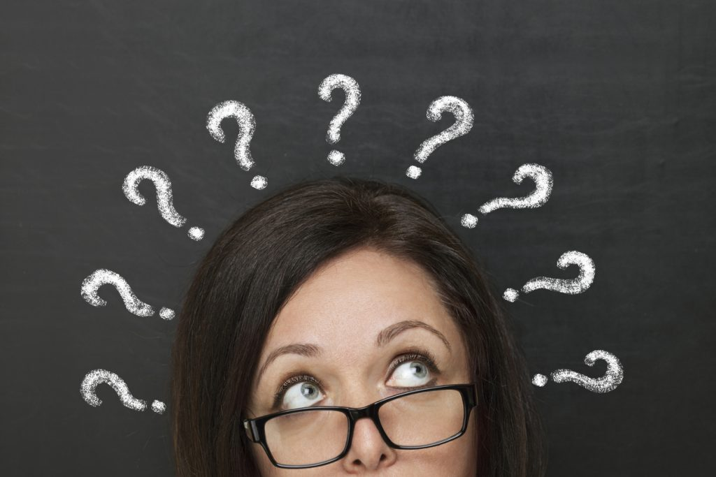 Lady with question marks over her head
